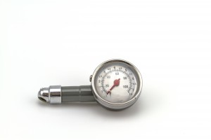Analog, dial air pressure gauge.